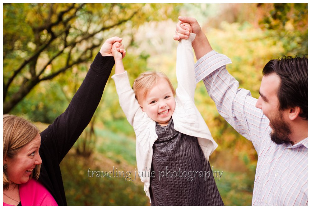 Smiling jumping daughter candid family photography portland